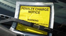 A photograph of a penalty charge notice on a car