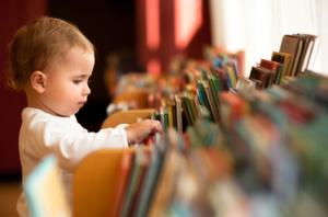 Baby browsing library books