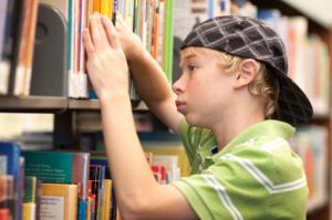 Boy browsing in library