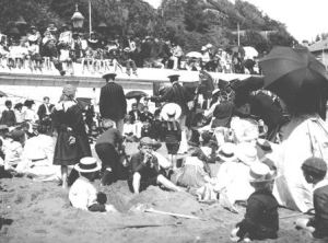 Holidaymakers on a beach at Sandown.  1890-1914