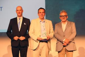 Director of regeneration, Chris Ashman, pictured, centre, with the award at the congress in Mallorca.