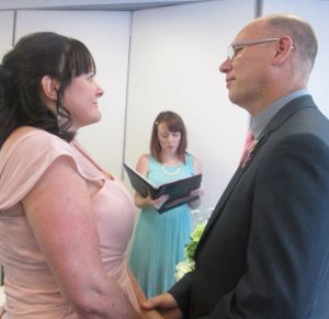 Registrar Stacey Gough conducts the remarriage of her parents Julie and Stuart Gough
