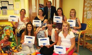 Peer supporters with Councillor Phil Jordan at East Newport Children's Centre