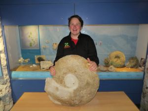 Alex Peaker with the ammonite he discovered which is now on display in the museum