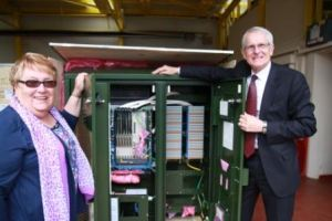 Executive member for economy and tourism, Councillor Shirley Smart, is shown one of the new rural broadband cabinets by BT's Peter Cowen