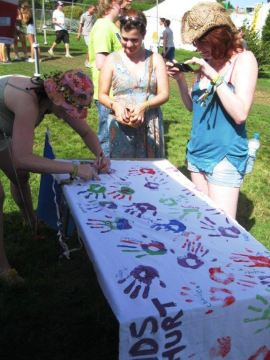At last year's Bestival, the team created a banner using people's hand prints with the slogan 'these hands don't hurt'