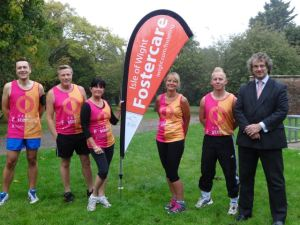 The team in their fetching running vest before their training run. Pictured with them is Councillor Jonathan Bacon.
