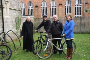 Father Luke Bell, Matt Noyce, councillor Ivor Warlow and Executive member for sustainability, environment, Luisa Hillard with the new bicycle racks.