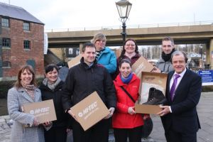The winning team from the council's trial workplace challenge event received walking boots from sponsors Hi-Tec