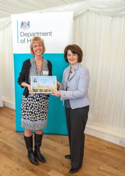Jane receiving her certificate from Jane Ellison MP