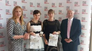 Nicky (centre left) is pictured receiving her award at the SS Great Britain in Bristol
