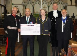 The cheque presentation took place after the Armed Forces Day flag was raised in Newport