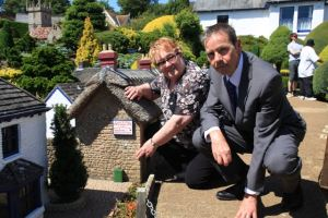 Councillor Smart with John Taylor, BT senior network engineer, showing the miniature cabinet in Godshill Model Village.