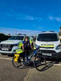 PCSO Cath Quin with the electric bike which has been provided through the Key Worker Cycle Scheme.